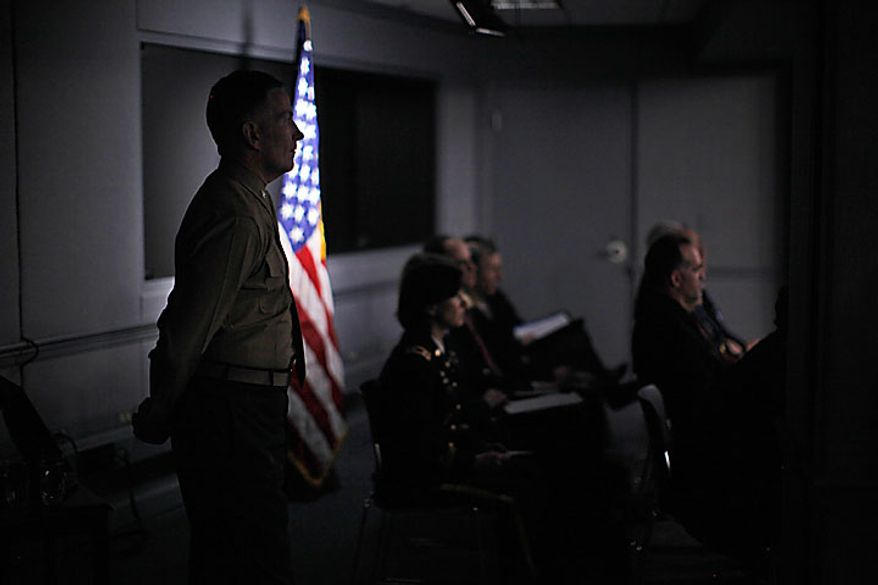 Pentagon military and civilian staff members listen as Defense Secretary Robert Gates and Joint Chiefs Chairman Adm. Mike Mullen, speak to reporters on gays in the military, Tuesday, Nov. 30, 2010, at the Pentagon. (AP Photo/Charles Dharapak)