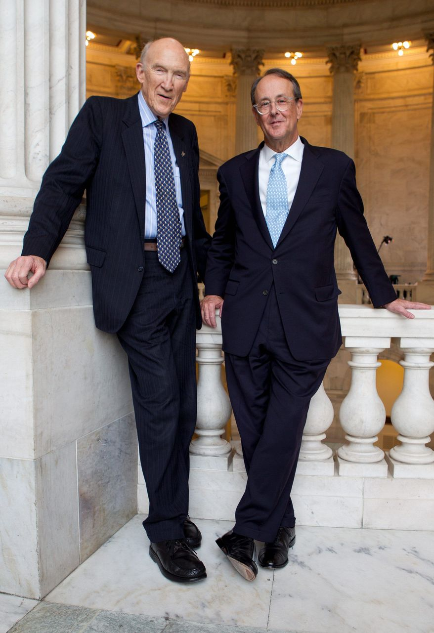 BLOOMBERG Erskine Bowles (right) and Alan Simpson, co-chairmen of the president's deficit commission, challenged the panel's members to put aside partisan differences and agree to its tax and budget recommendations.