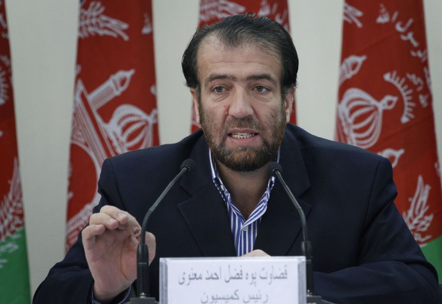 Election commission Chairman Fazel Ahmad Manawi speaks in Kabul, Afghanistan, on Wednesday, Dec. 1, 2010, during the announcement of the country's final election results. (AP Photo/Musadeq Sadeq)