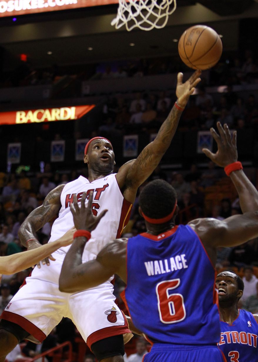 Miami Heat's LeBron James, left, goes to the basket as Detroit Pistons' Ben Wallace (6) defends in the first quarter of an NBA basketball game in Miami, Wednesday, Dec. 1, 2010. (AP Photo/Alan Diaz)
