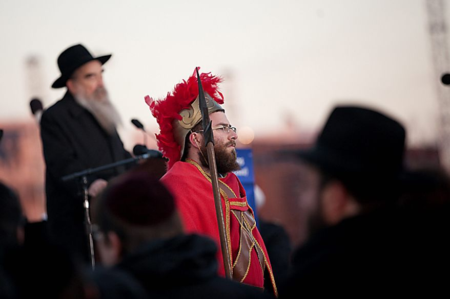 A man dressed as a Maccabee takes part in the the National Menorah lighting ceremony in celebration of Hanukkah on the Ellipse near the White House on Wednesday, Dec. 1, 2010, in Washington.  (AP Photo/Evan Vucci)