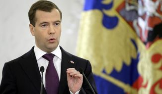 Russian President Dmitry Medvedev speaks in Moscow's Kremlin on Tuesday, Nov. 30, 2010, during his annual address to both houses of parliament. (AP Photo/Misha Japaridze)