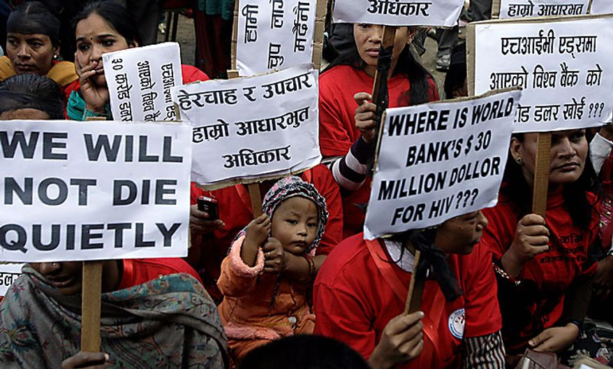 Nepalese HIV-positive people and activists hold placards demanding access to adequate medical services during a rally to mark World AIDS Day in Katmandu, Nepal, Wednesday, Dec. 1, 2010. (AP Photo/Binod Joshi)