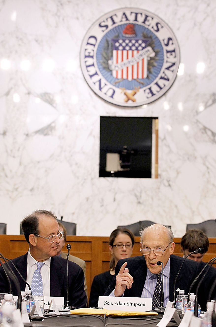 Debt Commission co-chairmen Erskine Bowles, left, and former Wyoming Sen. Alan Simpson, take part in a meeting of the commission on Capitol Hill in Washington, Wednesday, Dec. 1, 2010. (AP Photo/Alex Brandon)