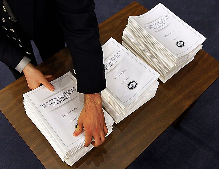 The Debt Commission report is brought out before their meeting on Capitol Hill in Washington, Wednesday, Dec. 1, 2010. (AP Photo/Alex Brandon)