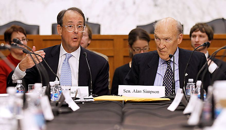 Debt Commission co-chairmen Erskine Bowles, left, and former Wyoming Sen. Alan Simpson, speak during a meeting of the commission on Capitol Hill in Washington, Wednesday, Dec. 1, 2010. (AP Photo/Alex Brandon)