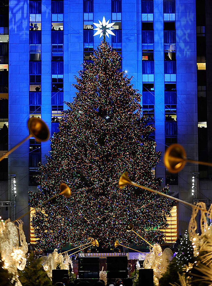 The Rockefeller Center Christmas tree stands lit during the 78th annual lighting ceremony Tuesday, Nov. 30 , 2010 in New York. (AP Photo/Stephen Chernin)