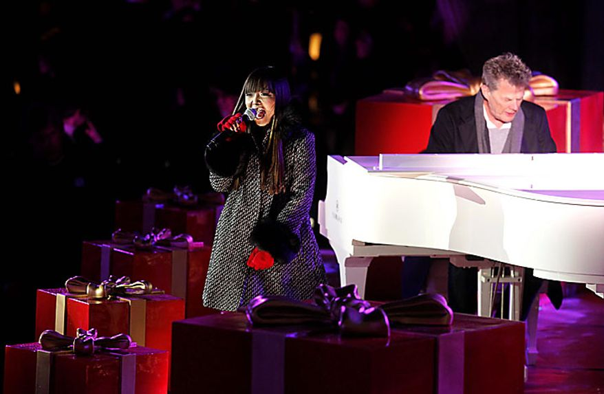 Singer Charice performs during the 78th annual Rockefeller Center Christmas tree lighting ceremony Tuesday, Nov. 30, 2010, in New York. (AP Photo/Jason DeCrow)