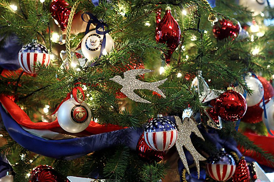 """A military appreciation Christmas tree is seen at the East Entrance Landing of the White House in Washington, Wednesday, Dec. 1, 2010.  The theme for the White House Christmas 2010 is """"Simple Gifts"""". (AP Photo/Charles Dharapak)"""