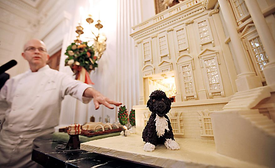 """White House pastry chef Bill Yosses speaks about the 2010 White Chocolate Gingerbread House featuring marzipan replicas of the Obama family dog, Bo, and the White House Kitchen Garden, Wednesday, Dec. 1, 2010, in the State Dining Room of the White House in Washington. The theme for the White House Christmas 2010 is """"Simple Gifts"""". (AP Photo/Charles Dharapak)"""