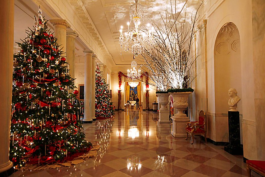 """The Cross Hall, looking towards the East Room is seen as the State Floor of the White House is decorated for Christmas, Wednesday, Dec. 1, 2010, in Washington. The theme for the White House Christmas 2010 is """"Simple Gifts"""". (AP Photo/Charles Dharapak)"""