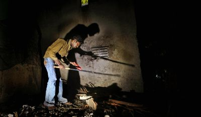 ASSOCIATED PRESS PHOTOGRAPHS Sabid Ali Sheikh hunts for rats in a Mumbai neighborhood situated between a 50-acre slaughterhouse and a city dump. He has to kill 30 rats a night, six nights a week, or he won't get his $271-per-month pay.