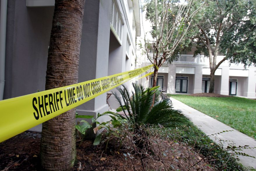 ASSOCIATED PRESS Yellow crime-scene tape in front of a condo where a 58-year-old man was murdered over the long Thanksgiving weekend is a stunning sight in Celebration, Fla., a master-planned community built by the Disney company 14 years ago near Orlando.