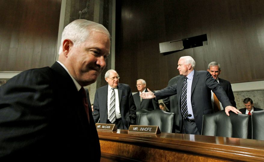 """ASSOCIATED PRESS Defense Secretary Robert M. Gates (left) arrives Thursday to testify to the Senate Armed Services Committee about the """"don't ask, don't tell"""" policy on gays in the military. Committee Chairman Sen. Carl Levin, Michigan Democrat, is greeted by Sen. John McCain of Arizona (right), the panel's ranking Republican."""