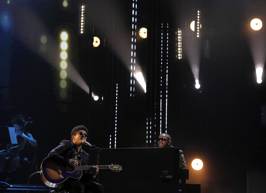 "Bruno Mars performs ""Just the Way You Are"" at the Grammy nominations concert on Wednesday, Dec. 1, 2010, in Los Angeles. (AP Photo/Matt Sayles)"