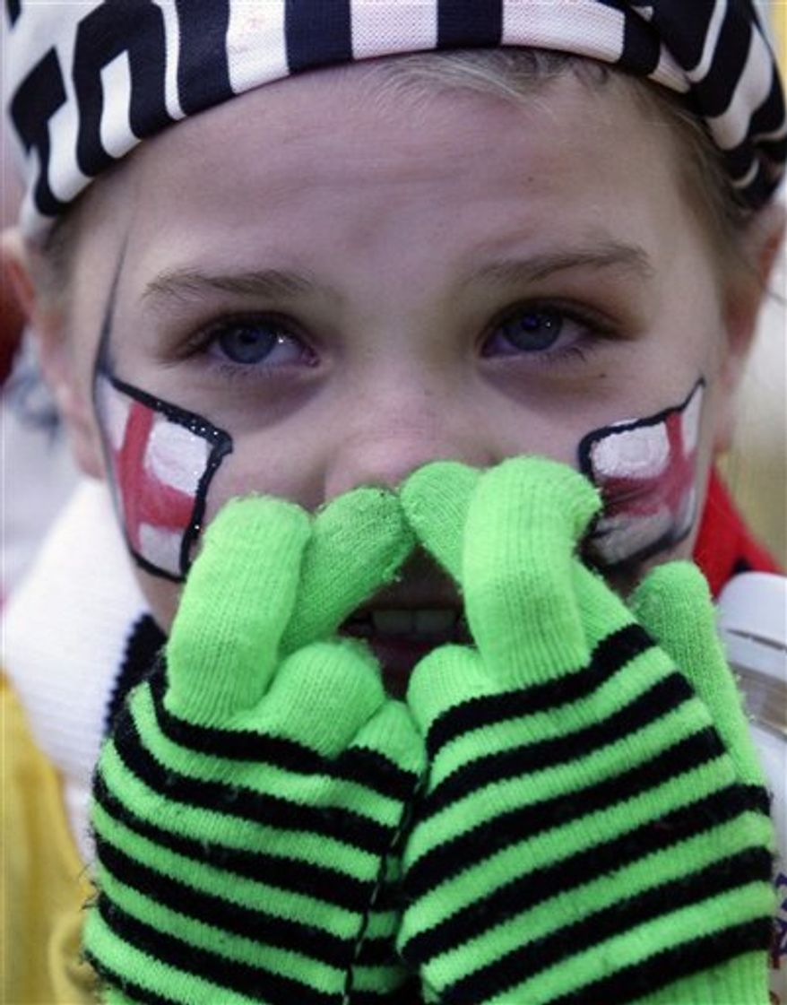 Manchester schoolgirl Rosaleen Sheenhan reacts by a screen in central Manchester as FIFA announces which bids have won the right to stage the 2018 and 2022 World Cups, Manchester, England, Thursday Dec. 2, 2010.  Russia won the vote and will host the 2018 World Cup.  (AP Photo/Jon Super)