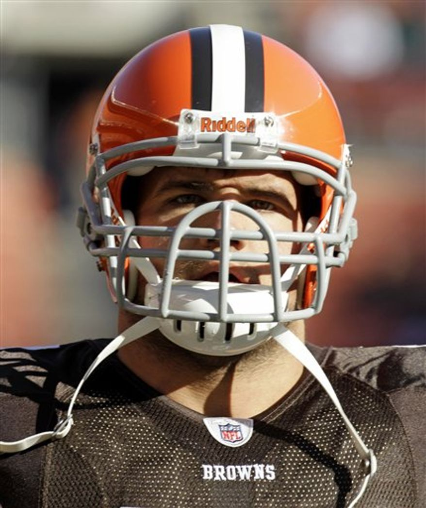 In this photo taken Sunday, Nov. 28, 2010, Cleveland Browns running back Peyton Hillis look son before the Browns play the Carolina Panthers in an NFL football game in Cleveland. Hillis' hog-nosed facemask is unlike any in the NFL. It's one of the things that makes him one of a kind among running backs. (AP Photo/Tony Dejak)