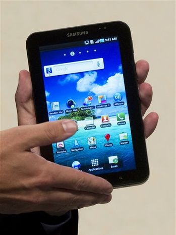 This product image provided by amazon.com Inc., shows the new Kindle 3 reader. (AP Photo/amazon.com Inc.)  NO SALES