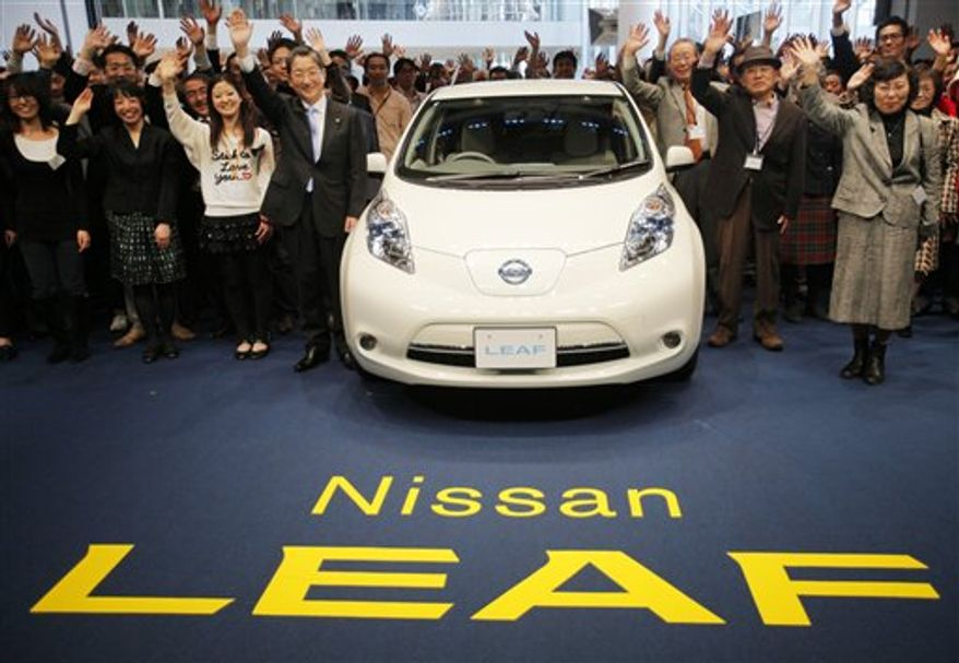 Nissan Motor Co. Chief Operating Officer Toshiyuki Shiga introduces the company's zero-emission electric car,  Leaf, during a news conference at its headquarters in Yokohama, Japan, Friday, Dec. 3, 2010. (AP Photo/Itsuo Inouye)