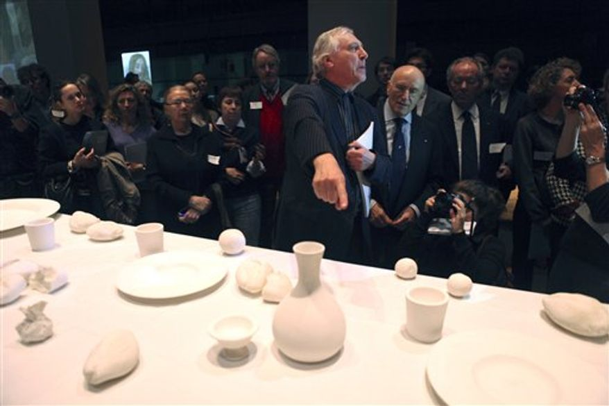 """Visitors enjoy a preview of the multimedia installation """"Leonardo's Last Supper: A Vision by Peter Greenaway,"""" in New York, Wednesday, Dec. 1, 2010.  The installation, which is based on Leonardo da Vinci's """"The Last Supper,"""" opens to the public on Friday, Dec. 3. 2010.  (AP Photo/Seth Wenig)"""