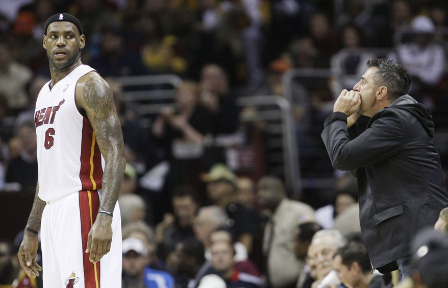 A Cleveland Cavaliers fan yells at Miami Heat forward LeBron James (6) during the first quarter in an NBA basketball game against the Cavaliers, Thursday, Dec. 2, 2010, in Cleveland. (AP Photo/Tony Dejak)
