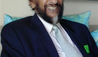 India's Rajendra Pachauri, chairman of the Intergovernmental Panel on Climate Change, smiles during an interview with The Associated Press in Cancun, Mexico, Tuesday, Nov. 30, 2010. The U.N. sponsored network of climate scientists said world governments must invest more in cutting-edge research to 'get a handle' on how much and how quickly the world will warm in decades to come. (AP Photo/Charles J. Hanley)