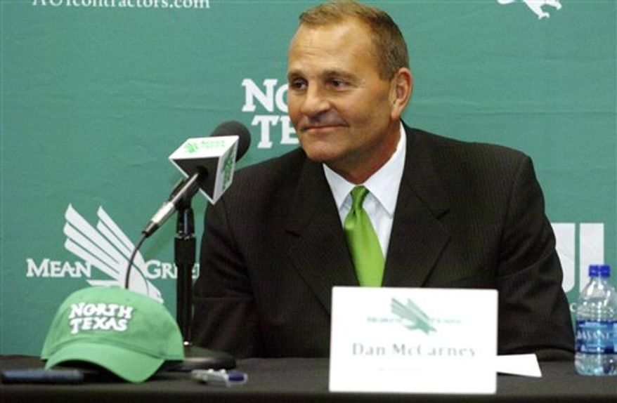 Dan McCarney smiles as he is introduced as the new University of North Texas football head coach during an NCAA college football news conference, Nov. 30, 2010, at the Mean Green Athletic Center in Denton, Texas. (AP Photo/Denton Record-Chronicle, David Minton)