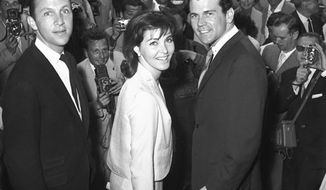 """FILE - In this May 1961 file photo, director Irvin Kershner, left, and actors Cindi Wood and Don Murray arrive at the Festival Palace at the Cannes Festival in Cannes, France, as their film """"Hoodlum Priest,"""" was presented at the festival. The agent for Kershner says the director of the """"Star Wars"""" sequel """"The Empire Strikes Back"""" has died at age 87. Agent Derek Maki says in an e-mail to The Associated Press on Monday, Nov. 29, 2010, that Kershner died during the weekend, but no further details are available. (AP Photo, File) NO SALES"""