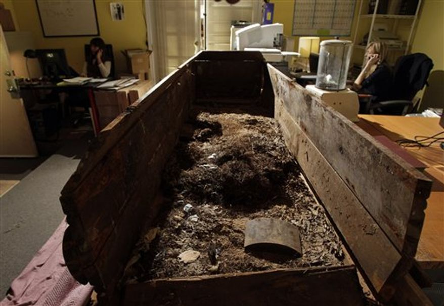 FILE - This file photo taken Wednesday, Dec. 1, 2010, shows the wooden coffin in which John F. Kennedy's assassin, Lee Harvey Oswald, was buried in,  seen at the Nate D. Sanders Auctions in Los Angeles. The ghoulish piece of American history is expected to be purchased  at auction by the end of the day Thursday, Dec. 16, 2010. (AP Photo/Jae C. Hong, File)