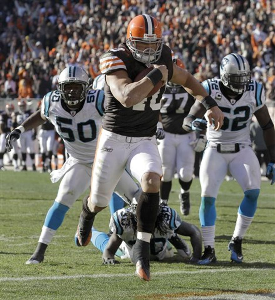 Cleveland Browns quarterback Jake Delhomme pumps his fist as he leaves the field after the Browns defeated the Carolina Panthers 24-23 in an NFL football game Sunday, Nov. 28, 2010, in Cleveland. (AP Photo/Tony Dejak)