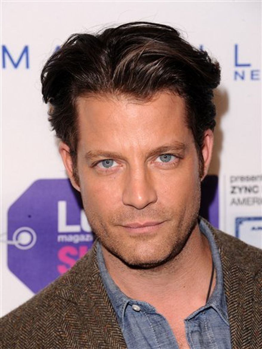 """FILE - In this Nov. 4, 2010 file photo, TV personality Nate Berkus attends the Lucky Shops """"VIP Night"""" to celebrate Lucky magazine's 10th anniversary in New York. Berkus is resting comfortably at home after an appendectomy. The popular designer and talk-show host had the surgery Tuesday, Nov. 30. (AP Photo/Peter Kramer, file)"""