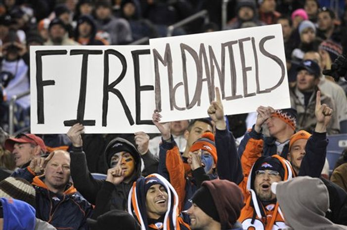 Fans hold a sign to fire Denver Broncos head coach Josh McDaniels during the second half of an NFL football game against the St. Louis Rams, Sunday, Nov. 28, 2010, in Denver. Many are wondering why McDaniels was allowed to hire a friend who had already run afoul of the NFL's rules back in New England and why he didn no do anything about it when Steve Scarnecchia brought him an illicit six-minute snippet of the practice. (AP Photo/Joe Mahoney)