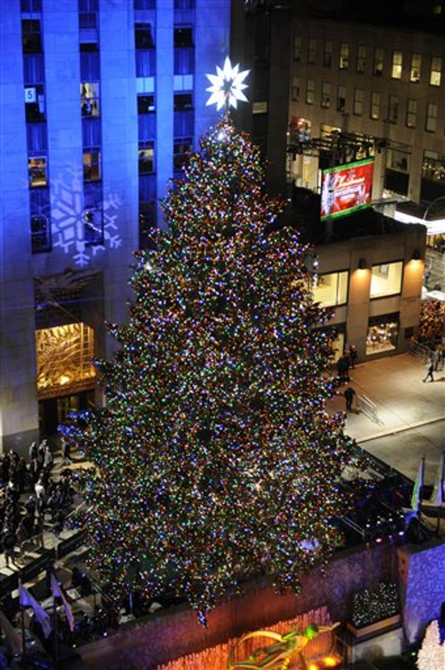 The Rockefeller Christmas tree,  a 12-ton, 74-foot Norway spruce covered with 30,000 energy-efficient lights , is lit in Rockefeller Center in New York, Tuesday, Nov. 30, 2010. (AP Photo/Henny Ray Abrams)