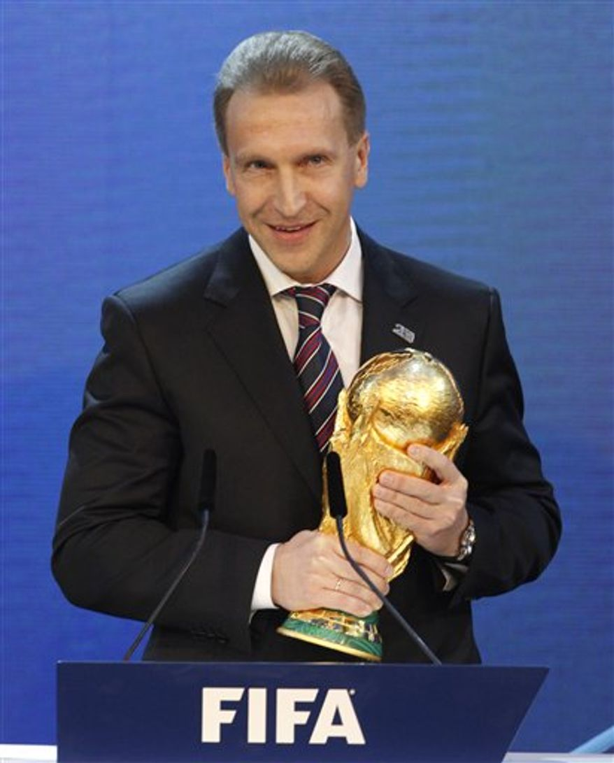 Igor Shuvalov, Russian Deputy Prime Minister, holds the World Cup Trophy after Russia was announced as host for the 2018 soccer World Cup  in Zurich, Switzerland, Thursday, Dec 2, 2010. (AP Photo/Keystone, Patrick B. Kraemer)