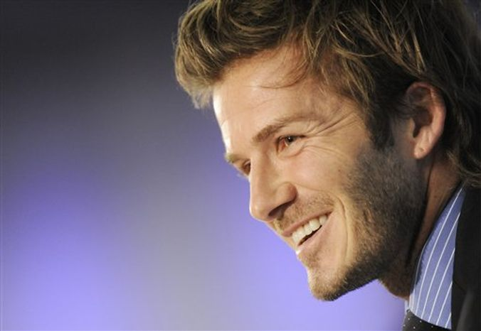 David Beckham, Vice  President of the England Bid team smiles during a media conference for the bidding nation England for the FIFA soccer World Cup 2018 / 2022 in Zurich, Switzerland, Wednesday,  Dec. 1, 2010. (AP Photo/Keystone, Walter Bieri )