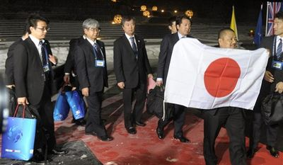 Members of the Japanese delegation arrive at the FIFA headquarters in Zurich, Switzerland, on Wednesday, Dec. 1, 2010, to present their bid to host the soccer World Cup 2022. (AP Photo/Keystone/Steffen Schmidt)