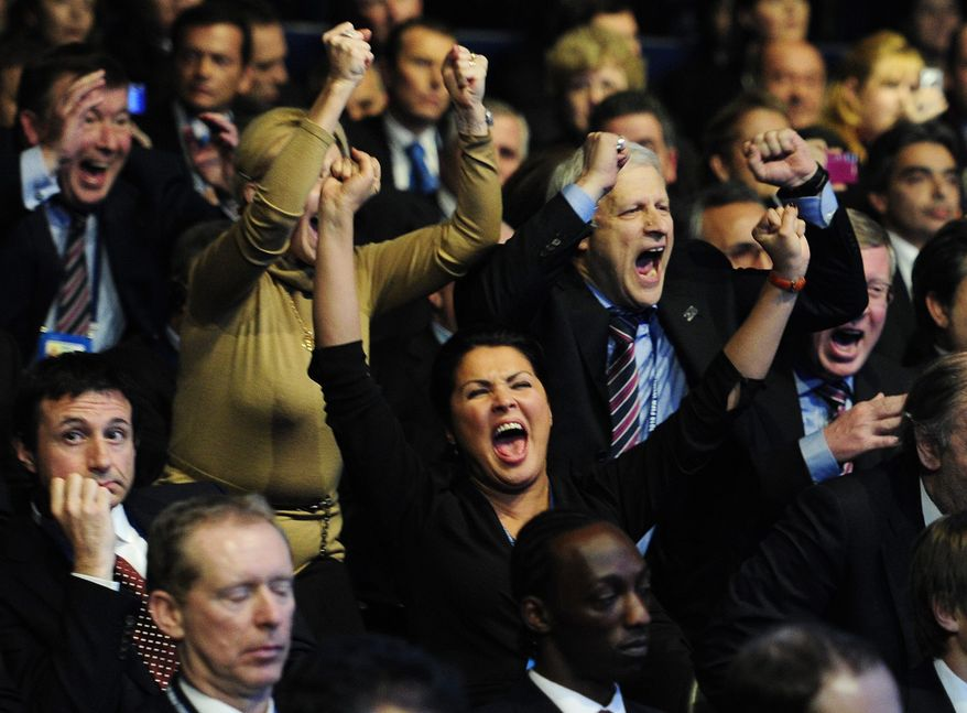 Members of the Russian delegation celebrate after Russia was announced as host for 2018 World Cup during the FIFA meeting in Zurich on Thursday, Dec. 2, 2010. (AP Photo/Keystone/Steffen Schmidt)