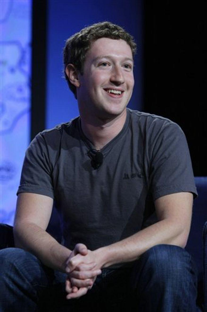 FILE - In this Nov. 16, 2010 file photo, Facebook CEO Mark Zuckerberg smiles as he speaks at the Web 2.0 Summit in San Francisco. (AP Photo/Paul Sakuma, file)