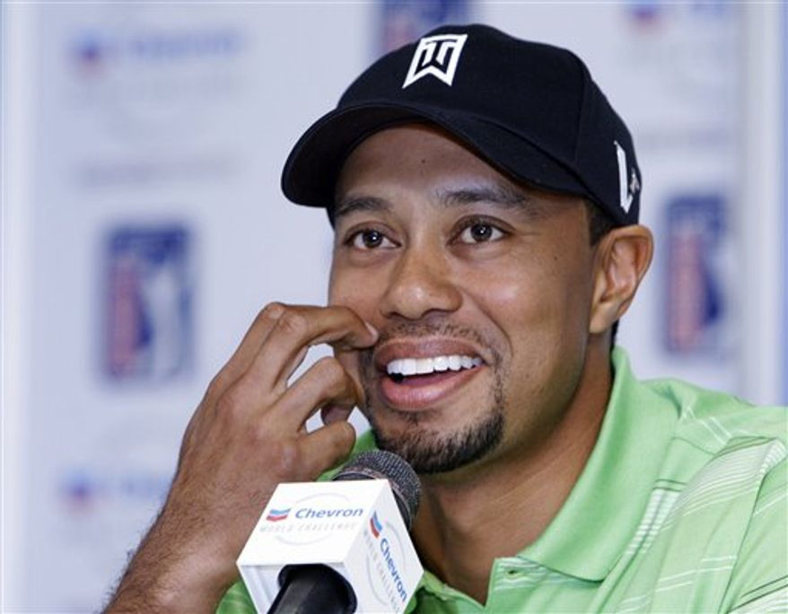 Tiger Woods addresses the media during a news conference at the the Chevron World Challenge golf tournament at Sherwood Country Club in Thousand Oaks, Calif., Tuesday, Nov. 30, 2010.  (AP Photo/Reed Saxon)