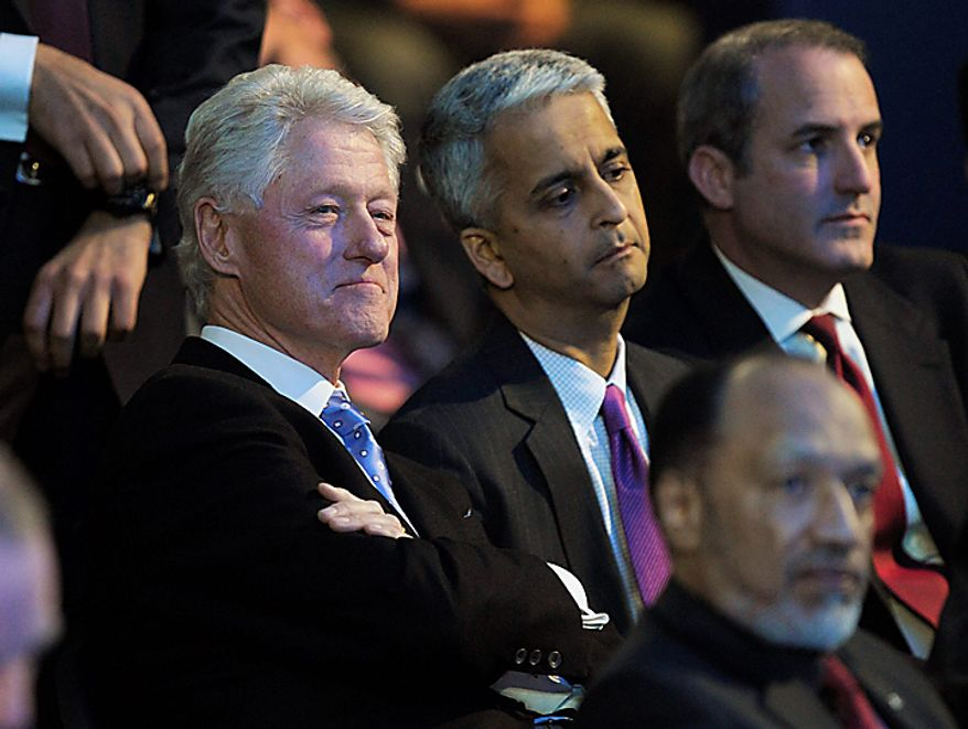 Former US President Bill Clinton, left, and Sunil Gulati, Chairman USA bid committee, right, look on after it was announced that Qatar will host the 2022 FIFA Soccer World Cup, in Zurich, Switzerland, Thursday, Dec. 2, 2010. (AP Photo/Keystone/Steffen Schmidt)