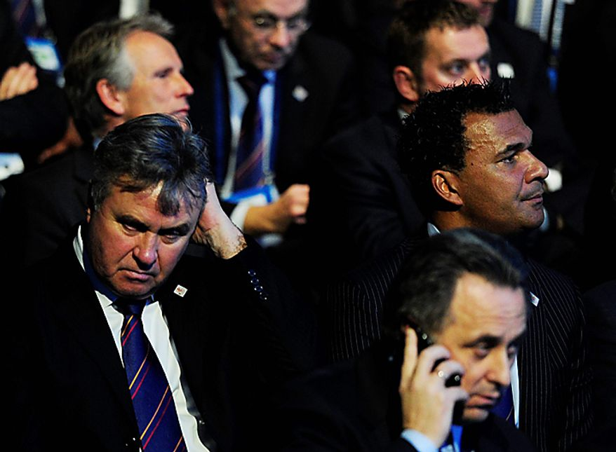Ruud Gullit, President of the Holland Belgium bid, right, and Guus Hiddink, left, look on after it was announced that Russia will host the 2018 FIFA Soccer World Cup, in Zurich, Switzerland, Thursday, Dec. 2, 2010. (AP Photo/Keystone/Steffen Schmidt)