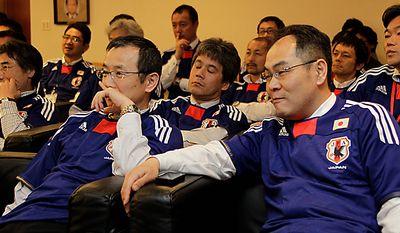 Japan Football Association officials  react as live TV broadcast announced that  Qatar will host the 2022 Soccer World Cup at  Japan Football Association headquarters in Tokyo, Japan, Friday, Dec. 3, 2010.  (AP Photo/Koji Sasahara)