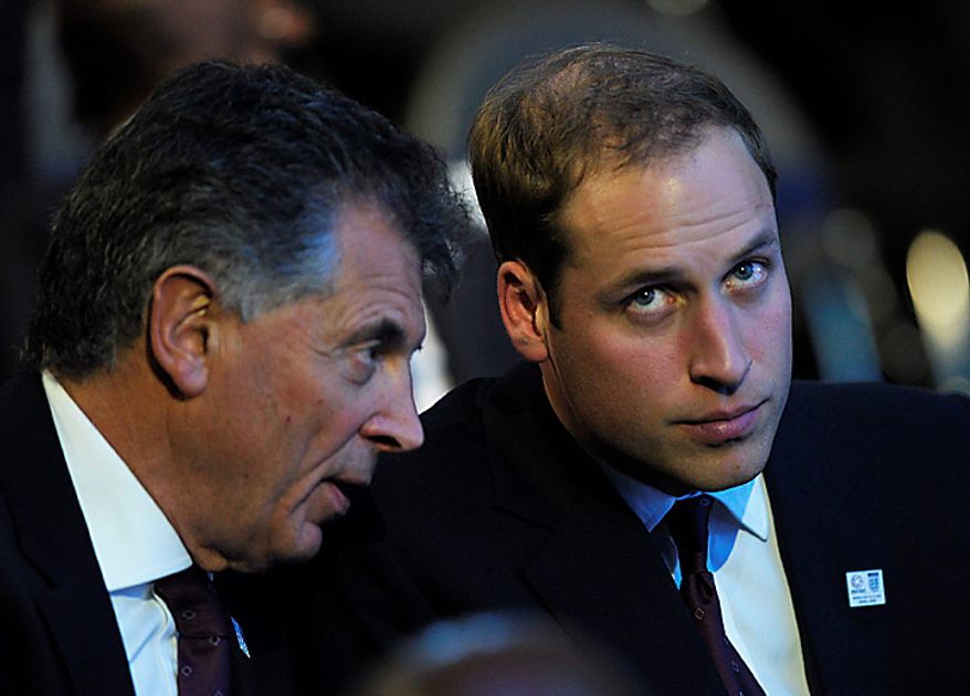 Prince Wiilliam of Wales, right, looks on after it was announced that Russia will host the 2018 FIFA Soccer World Cup, in Zurich, Switzerland, Thursday, Dec. 2, 2010. (AP Photo/Keystone/Steffen Schmidt)