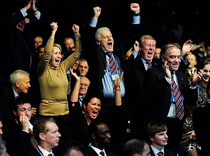 Members of the Russian delegation celebrate after Russia was announced as host for 2018 during the FIFA 2018 and 2022 World Cup Bid Announcement in Zurich, Switzerland, Thursday, Dec. 2, 2010.  (AP Photo/Keystone/Steffen Schmidt)