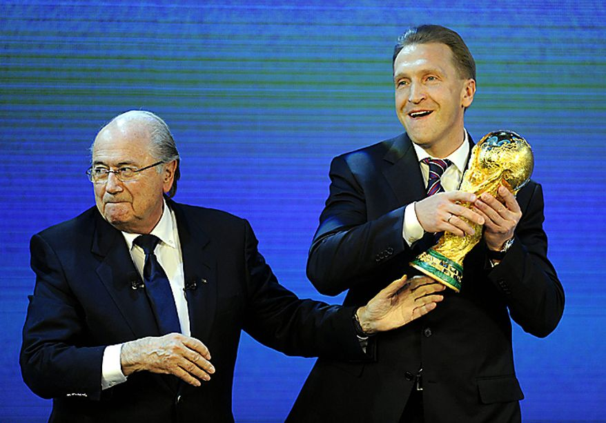 FIFA President Joseph S. Blatter, left,  hands over the trophy to  Russian First  Deputy Prime Minister Igor Shuvalow, right,  after Russia was announced as host of the 2018 Soccer World Cup, on Thursday, Dec.  2, 2010, during the FIFA 2018 and 2022 World Cup Bid announcement in Zurich, Switzerland. (AP Photo/Keystone /Walter Bieri)