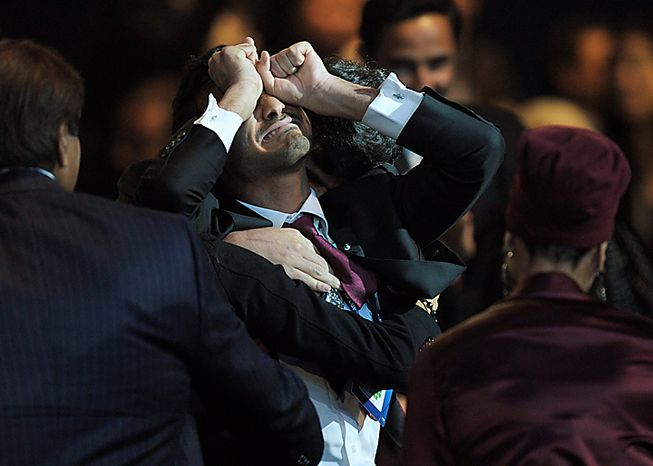 Members of the Qatar delegation celebrate after it was announced that Qatar will host the 2022 FIFA Soccer World Cup, in Zurich, Switzerland, Thursday, Dec. 2, 2010. (AP Photo/Keystone/Steffen Schmidt)