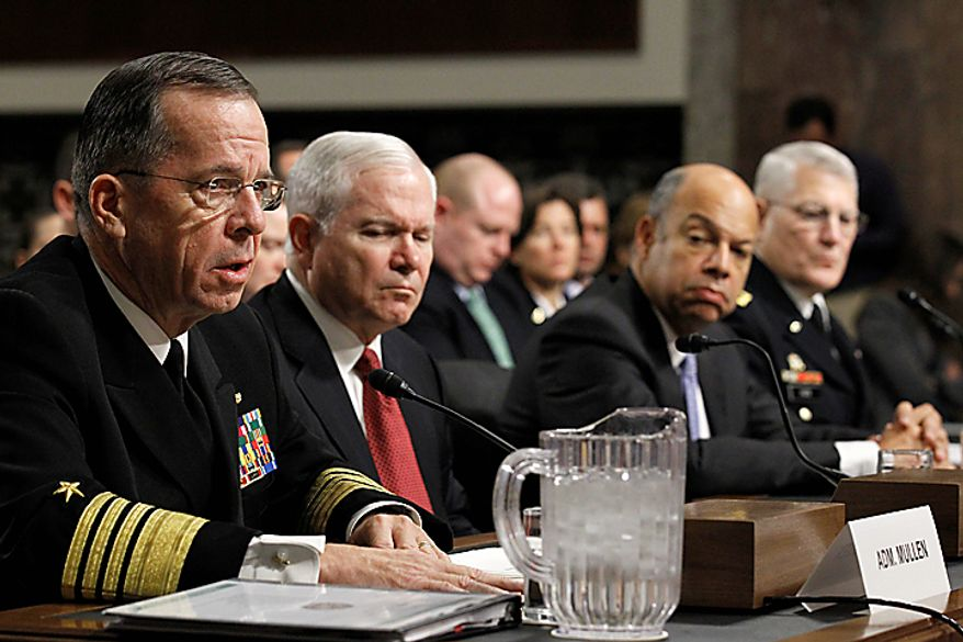 From left, Joint Chiefs Chairman Adm. Michael Mullen, Defense Secretary Robert Gates, Defense Department general counsel Jeh Johnson, and Gen. Carter Ham, commander of the United States Army Europe and co-chairman of the Comprehensive Review Working Group, testify on Capitol Hill in Washington Thursday, Dec. 2, 2010, before the Senate Armed Services Committee's Don't Ask Don't Tell policy hearing. (AP Photo/Alex Brandon)