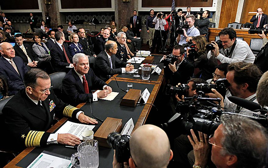 From left, Joint Chiefs Chairman Admiral Michael Mullen, Defense Secretary of Defense Robert Gates, Defense Department general counsel Jeh Johnson,  Gen. Carter Ham, commander of the United States Army Europe and co-chairman of the Comprehensive Review Working Group, take their seats on Capitol Hill in Washington Thursday, Dec. 2, 2010, prior to testifying before the Senate Armed Services Committee's Don't Ask Don't Tell policy hearing. (AP Photo/Alex Brandon)