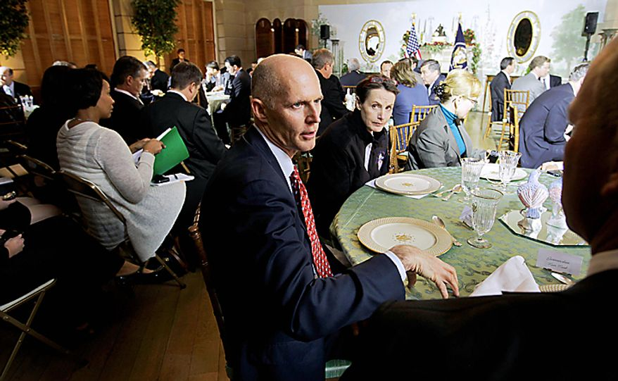 ** FILE ** Then Florida Gov.-elect Rick Scott, center, attends a luncheon with White House administration officials, before President Barack Obama arrives, on Thursday, Dec. 2, 2010,  at the Blair House across from the White House in Washington. (AP Photo/Charles Dharapak)