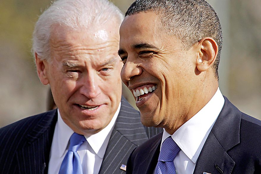 ** FILE ** President Obama talks with Vice President Joseph R. Biden Jr. as they walk to the Blair House from the White House in Washington on Thursday, Dec. 2, 2010, for a meeting with newly elected governors. (AP Photo/J. David Ake, File)